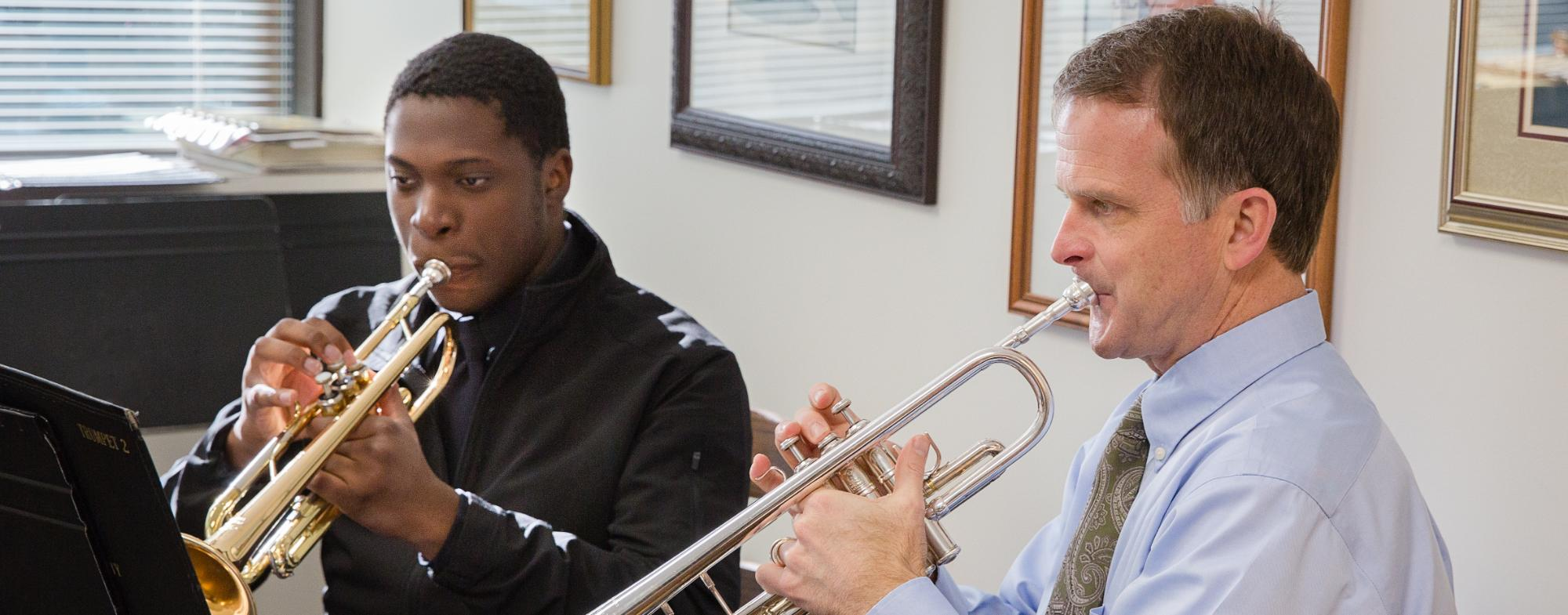 A student has a trumpet lesson with Dr. Bruce Cox